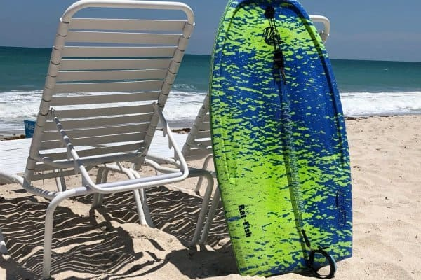 Rented boogie board resting on beach chair on Vero Beach